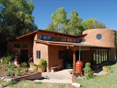 Custom Designed Passive Solar Adobe Home, curved walls, high ceilings, big views