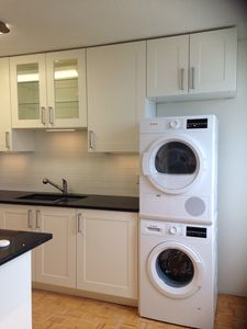 Newly renovated kitchen with in-suite laundry facility and dish washer