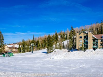 Photo for Cozy ski in/ski out condo on chair 8! Stay nice and toasty with your wood burning fireplace while yo