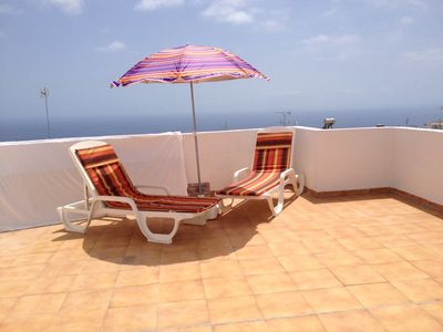 Photo for Adeje center-attic with terraces overlooking the sea and the pool