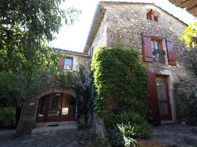 Photo for Rare! Stone village house 4 bedrooms - 2 bathrooms with garden in the heart of Goudargues
