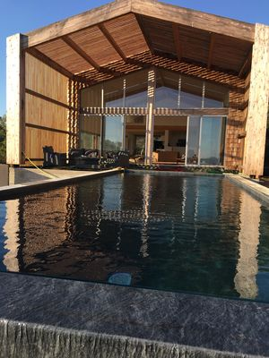 Photo for Architect villa with pool and sea view, in a preserved environment