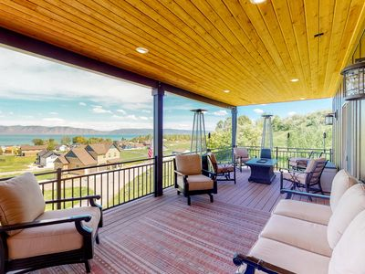 Photo for NEW LISTING! Spacious home w/ lake view, private hot tub, & covered deck!