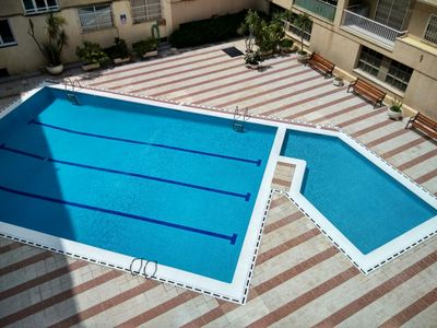 Photo for PINEDA - FACING THE SEA - Apartment on the beach with communal pool