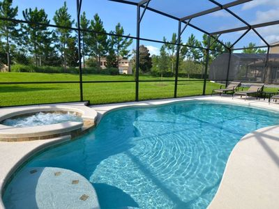 Photo for 5 Bedroom 4 Bathroom Pool Home just 10 minutes away from Disney. 9109SC