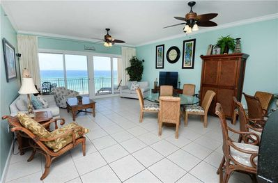 Welcome to this bright, airy, well-furnished ocean-view condo! - There's room for everyone to gather in the living room for games, TV, or to watch the beautiful sunsets! The sofa unfolds into a bed for 2, giving some lucky couple ocean views!