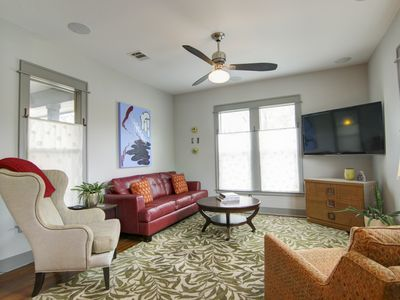 Living Room - Lots of natural light in this relaxing carpeted living room equipped with cable TV