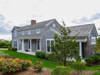 Custom home with screened in patio porch and decks for views.