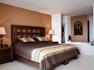 Master bedroom king bed with jetted bath, private balcony, walkin and safety box