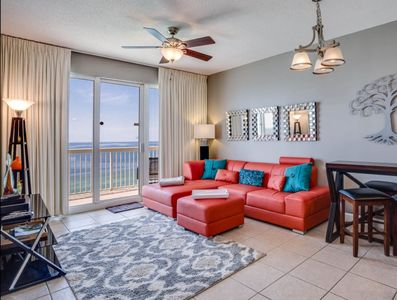 Gulf Front Living + Master Bedroom with modern, comfortable furniture