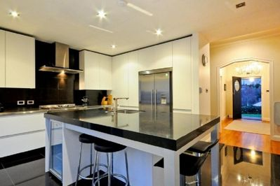 Stunning modern kitchen has everything you need for your stay & more.
