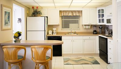 kitchen includes dishwasher, full size stove, microwave and seating