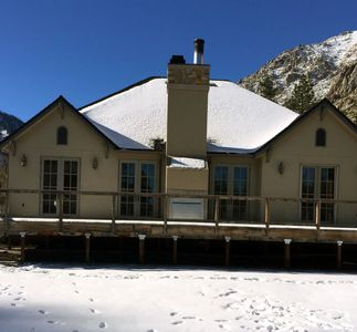 View of the large deck on the back of the house during the winter.
