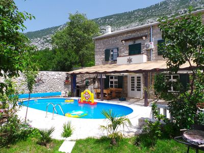 Photo for Holiday house with covered terrace, summer kitchen and outdoor pool