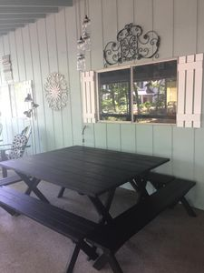 Screened porch table seats 8-12 easily!
