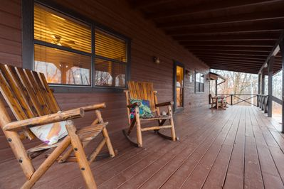 This is one of THREE huge covered porches/decks for ultimate lounge time.