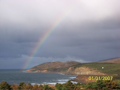 Rainbow over the house (atop the hill).