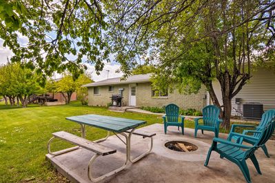 The property boasts a backyard with a grill, fire pit, and more!