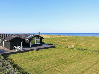 Photo for Seaside Holiday Home in Jutland with outdoor seating and terrace