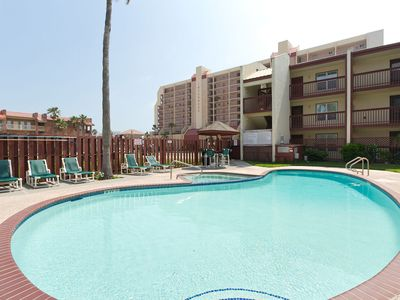 Photo for Remodeled condo across the street from the beach with pool and hot tub!