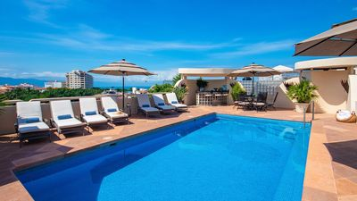 Photo for UPSCALE VILLA IN DOWNTOWN W PRIVATE POOL JACUZZI STAFF STUNNING DECOR
