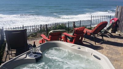 Large patio next to the deck sitting on the oceanfront, BBQ, seating, hot tub
