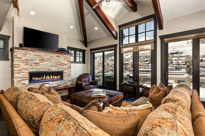 Living Room with Flat Screen TV, Gas Fireplace and Balcony Access
