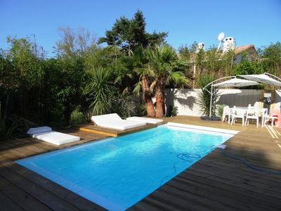 Photo for Wood modern cabin with pool 200m from the beach and market bicycles
