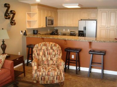 Breakfast Bar and gourmet Kitchen with new, top of the line stainless appliances