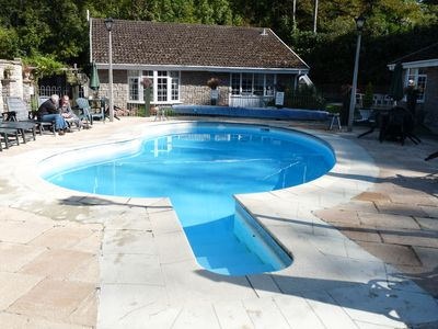 Heated outdoor pool and communal social area.