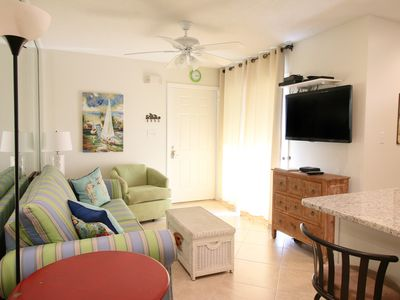 Comfortable den with  beachy decor at Endless Summer with a large flat screen T