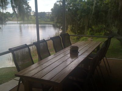 Back screened porch with dining table for 10-12