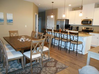 Open floorplan featuring kitchen with granite counters and stainless appliances.