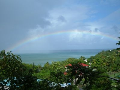 Beautiful rainbow over the sea as seen from the balcony of the apartment.