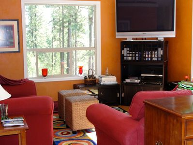 Relax and watch TV or play board games in the comfy living room.