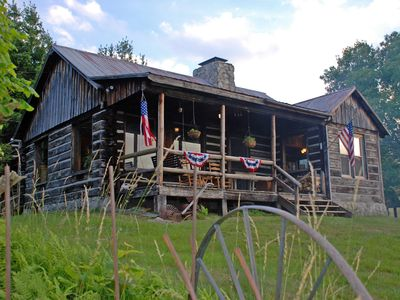 Photo for Secluded rustic log cabin at 4,000 ft with spectacular views & modern amenities.