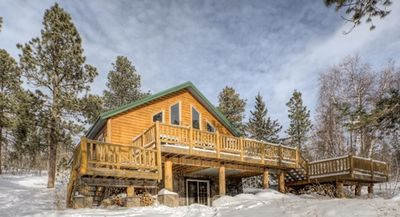 Moostracks- Rustic lodge located 1/4 miles from Terry Peak Ski Slopes, Private, hot tub, wood fireplace
