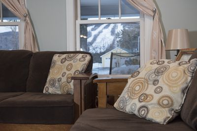relax in the living room, watch the groomers and skiers