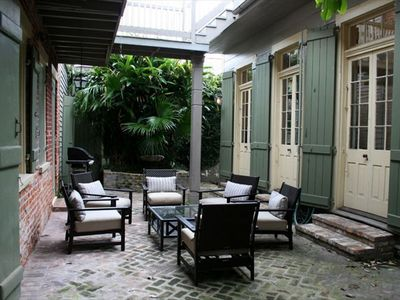 Six sets of French doors open to private courtyard -- perfect for entertaining.