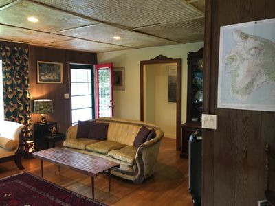 Living room is furnished with antiques and unique island art