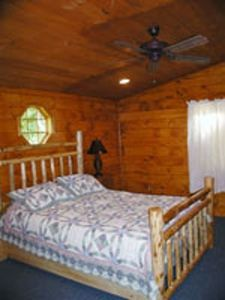 Bass Bunk Master Bedroom with Queen Adirondack log bed.