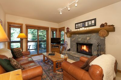 Cozy Living Room with Fireplace, Flat Screen TV