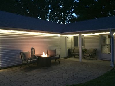Patio with gas fire feature. Have coffee in the morning and take the chill off.