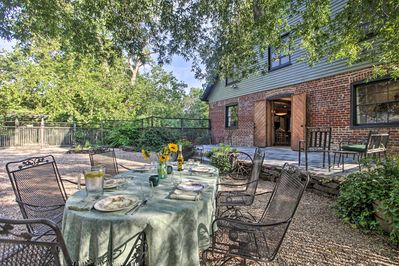 The 5-bedroom, 3.5-bathroom brick home features beautifully appointed grounds.