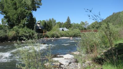 Photo for Luxury Town Home  Down Town Over Looking the River, 1 Minute Walk to Hot Spring