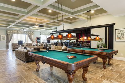 Upstairs Grande Room - Designed to provide the ultimate experience for families or corporate retreats.  Featuring two 8 foot billiards, TVs everywhere, seating for all and an incredible home theater that opens up.