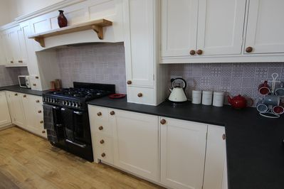 Fully equipped kitchen with range gas cooker.