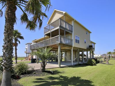 Photo for PRICE REDUCED 10%! Hot tub, beach and bay views! This luxury home makes your beach vacation AMAZING!  HUGE yard with Palapa, outdoor lights, café lights and a firepit! Ask about $115/night in free activities including a ticket for Schlitterbahn Waterpark per day. Concierge services available.
