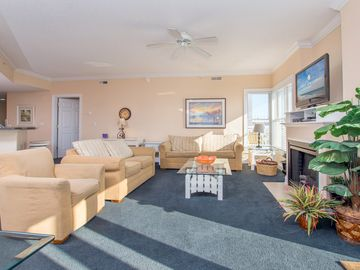 Walk to the beach or cross the street to the Convention Center from this mid town ocean block condo