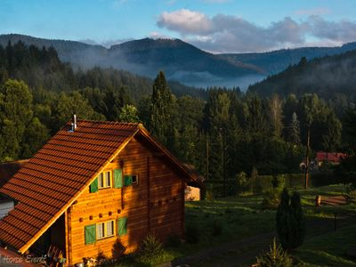 Photo for Very quiet wooden house with log sauna in a charming environment